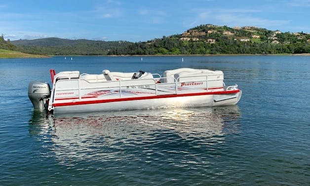 Party Tritoon   rated 15 person 150 HP engine with bimini top