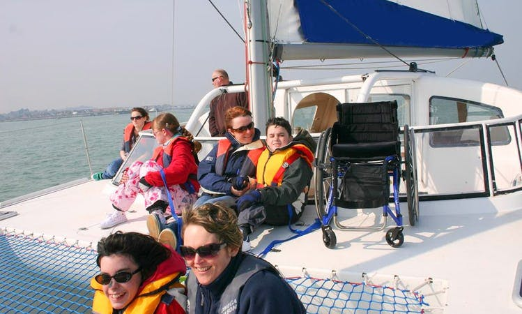 Sail on Wheelchair Accessible Catamaran around the Solent in England